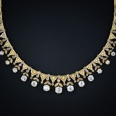 A truly remarkable and ravishing antique diamond necklace of mid-Victorian vintage. Masterfully crafted in 15 karat yellow gold, this radiant beauty is comprised of ninety-two graduated sections: Forty-five old mine-cut diamonds, weighing 12 carats total, swing freely from a classic rose-cut diamond set leaf motif. These main sections alternate with forty-five exquisitely ornamented hand-pierced and hand-chased tapered plaques - each with a tiny rose-cut diamond at the bottom tip.