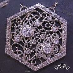 Custom carved and cast hexagonal shaped pendant with scroll filigree and leaves.