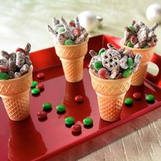 Classroom Christmas party snack idea: Reindeer Munchies - This is a sweet and easy recipe the kids can help make. Santa and the elves will gobble it up. I like the idea of putting treats in the cone. by carolyn