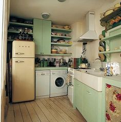 Tiny kitchen with a retro fridge and it looks like even the washing machine is in there too!