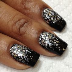Black nails with silver glitter near cuticles