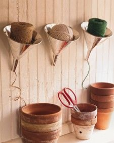 If your craft supplies look anything like ours, odds are your balls of string, yarn, and twine are forever getting tangled in knots. For a playful fix, hang old funnels on your craft room wall for easy storage and a cool new look!   Transform old funnels into string dispensers