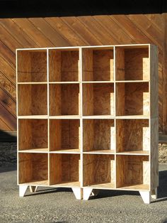 Handmade modular cubby bookshelves (made of oriented strand board, an eco-friendly alternative to plywood)