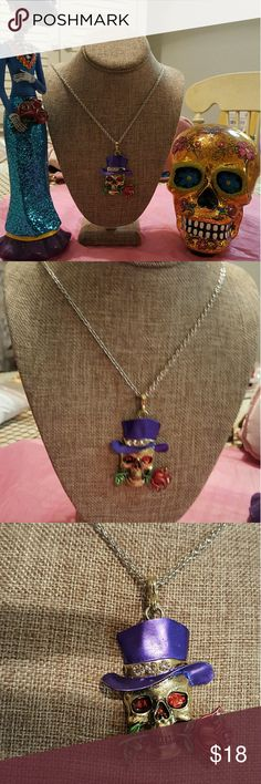 """New Day of the Dead, Skull necklace, Gorgeous,  new Day of the Dead Skull necklace. He has a purple tophat w/rhinestones,  red eyes and a rose in his teeth. Spectacular colors , 25 1/2"""" long. Trending for Fall this Day of the Dead skull necklace is vibrant and can also be worn for Halloween.  It's a piece you'll receive many compliments on and a conversation starter.  NWOT.  From the spectacular city of New Orleans 💜💜💜. All of my items are 20% off a bundle of 3. My closet full of lots of…"""