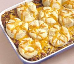 Ground beef, beans, corn, and taco seasoning make the base for this fun casserole. Cheese and biscuits are baked on top.