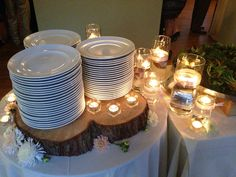 We used an actual old tree stump for a plate riser for a recent wedding we produced. So Pretty.