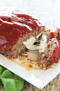 People go crazy over my MOZZARELLA STUFFED MEATLOAF. Flavorful ground beef stuffed with ooey gooey mozzarella cheese. This Mozzarella Stuffed Meatloaf is sure to become an instant family favorite! Yummy Recipes, Meat Recipes, Cooking Recipes, Yummy Food, Dishes Recipes, Snacks Recipes, Recipies, Sauce Recipes, Sirloin Recipes