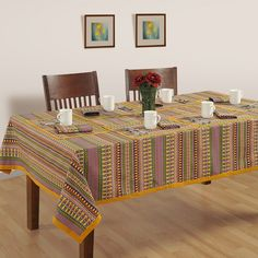 Buy printed blue and green artistic stripes table covers at Saavra and create the ambience of a party by placing artistic stripe theme covers on your table.