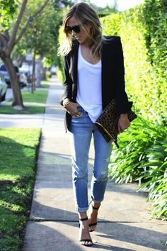 Shop this look on Lookastic: https://ca.lookastic.com/women/looks/blazer-crew-neck-t-shirt-boyfriend-jeans/18988 — White Crew-neck T-shirt — Black Blazer — Dark Brown Leopard Suede Clutch — Light Blue Ripped Boyfriend Jeans — Black Suede Heeled Sandals