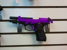 Beretta Pistol in passion purple. Hmm bigger than I like for a gun, but pretty.