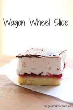 This Wagon Wheel Slice features a soft biscuit base topped with a layer or raspberry jam, white fluffy marshmallow and dark chocolate.