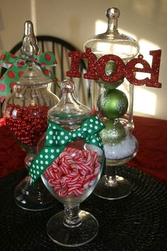 dollar tree thanksgiving decorations | Apothecary jars on the dining room table filled with green ornaments ...