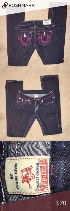 True Religion, dark blue w/ hot pink logo jeans Straight leg, but not skinny/legging. Still a nice taught fit on thighs and butt. Very rarely worn and in perfect condition. No noticeable fade in color at all. White and pink stitching throughout. True Religion Pants Straight Leg