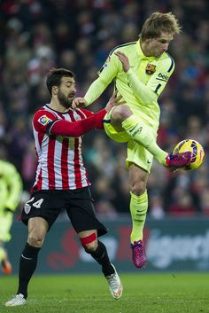 Ivan Rakitic of FC Barcelona duels for the ball with Mikel Balenziaga of Athletic Club during the La Liga match between Athletic Club and FC Barcelona at San Mames Stadium on February 8, 2015 in Bilbao, Spain.