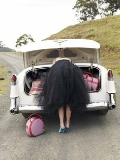 When I close my eyes and imagine I am on a road trip this is how I see me. Vintage car, pink luggage......