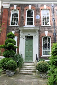 Green Door. 4 Cheyne Walk, Chelsea, London, bearing date 1718; the home, in 1881, of George Eliot. Via Flickr.