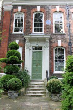 Green Door. 4 Cheyne Walk, Chelsea, London, bearing date 1718; the home, in 1881, of George Eliot. Via Flickr.