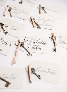 Brass key tag escort cards featuring gorgeous calligraphy. Photo by Rebecca Yale Portraits