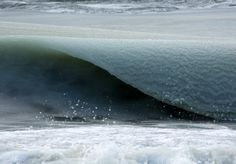 Frozen waves in Nantucket! At -7.2°C, the waves are thick with pieces of ice, like a Slurpee. Photo © Jonathan Nimerfroh