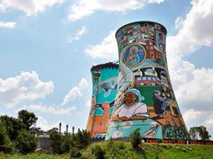 """Standing for """"South Western Townships,"""" Soweto is a sprawling yet culturally significant district within Johannesburg. It's the birthplace of Nelson Mandela, and his childhood bricked home still stands, preserved as a museum. Also of note in the area are the Orlando Power Station Cooling Towers, which have been painted with captivating murals depicting the community, music, and Mandela himself. Brave souls can bungee jump from a platform between the two 300-foot towers."""