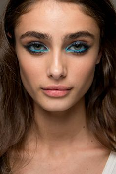 Bright blue eyes took centre stage at Elie Saab where makeup expert Tom Pecheux using MAC layered different azure shades top and bottom. So beautiful.   -Cosmopolitan.co.uk