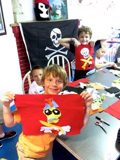 Summer art campers sew pirate flags at Creative Arts Inc.
