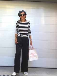 I love her wide belled cords with a mid waist. Paired with a jewel neck striped shirt with bracelet length sleeves, pushed up. Gray beret, sunnies, white watch and sneaks. She looks so at ease in her own skin. Style Planet