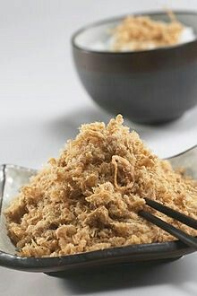 Rousong (pronounced [ɻôusʊ́ŋ]; Chinese: 肉鬆; Cantonese Yale: yuk6 sung1), also known as meat wool, meat floss, pork floss, flossy pork, pork sung or yuk sung, is a dried meat product with a light and fluffy texture similar to coarse cotton, originating from China.[1] Rousong is used as a topping for many foods, such as congee, tofu, and savoury soy milk. It is also used as filling for various buns and pastries, and as a snack food on its own. Rousong is a very popular food item in Chinese…