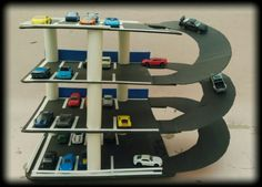 Hotwheels Parking garage, homemade with recycled materials such as cardboard, plastic rolls, recycled sheets etc. Breif detail in the comment box.