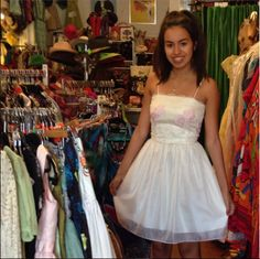Maya looks darling in her white party dress she scored at the shop!