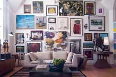 Great example of a gallery wall. eclectic living room by Adrienne DeRosa