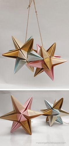 origami - móvil con estrella Omega plegada en papel