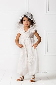 "A special lace harem jumpsuit with an attached hood made of excellent quality embroidered lace. A fashion statement for special occasions. AGNES jumpsuit is combined with matching shoes from the ""Designer's Cat Shoes"" collection. #kidsfashion #luxuryDresses #designersCat #collection #communie"