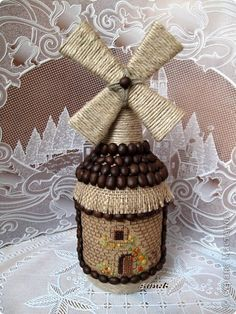 Upcycle bottle to windmill decor Wine Bottle Art, Diy Bottle, Wine Bottle Crafts, Art N Craft, Craft Stick Crafts, Diy And Crafts, Coffee Bean Art, Wrapped Wine Bottles, Jar Art