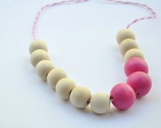 I made a similar one for myself but with a diff cord and all plain beads a year ago and it is one of my fav necklace! i also made another one for my niece but painted the three center beads and i love it too! Wooden Necklace DIY by Curly Birds