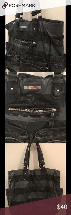 Juicy Couture Handbag Black and Grey stripe Juicy Couture large bag. Silver lures detail in straps. Lots of space and pockets! Gently used Juicy Couture Bags Shoulder Bags