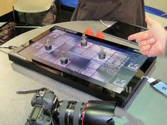 Imagine a board game where the board is actually a touch-sensitive tablet...