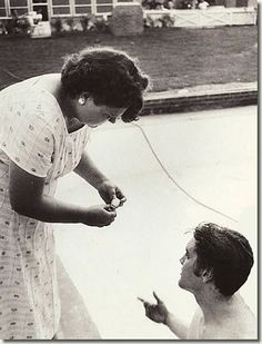 """Elvis Presley goes for a swim and ask his """"mama"""" to take his watch. Gladys look nice in this picture. I have never seen it before."""