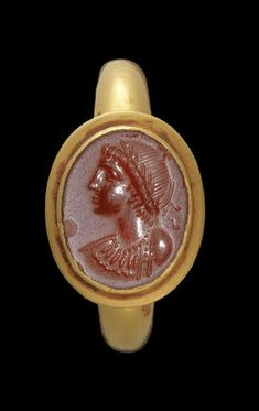 A Byzantine carnelian intaglio  Circa 4th-5th Century A.D. The oval ring stone set in a modern gold ring, engraved with a profile head wearing a wreath, earring and necklace, possibly an emperor.