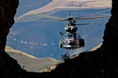 Oryx Helicopter hovering in the mountains. Helicopter Plane, Helicopter Pilots, Military Helicopter, Military Aircraft, Model Trains Ho Scale, Augusta Westland, C130 Hercules, South African Air Force, F14 Tomcat