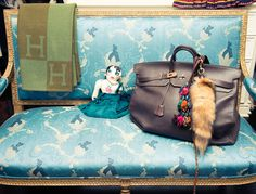 Love the vintage Hermes on the vintage French settee