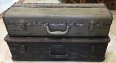 """Old fashioned metal tool boxes make an intriguing, rustic accent on a shelf or the floor. 26"""" x 12"""" x 7.75"""", 24"""" x 8"""" x 6.25. Part of a big consignment of designer accessories."""
