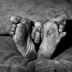 """""""Puppy Between Feet"""" (1999), in """"Outland,"""" a disturbing and personal series of images that focuses on poor whites in South Africa."""