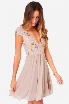 Babydoll floral blush chiffon bridesmaid dress: A gorgeous dress that is appropriate for any season, it's the mix of textures that gives it a feminine feel. The light pink is also a contributing factor, but we love the simple cut, the romantic chiffon skirt, and the light sparkle of the bodice and sleeves. | Short and Sparkly Bridesmaid Dresses