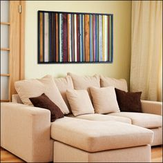 Wood Wall Art - India - Wood Stripes in Orange, Yellow, Blues, Reds Wall art is made with a mix of pine, alder, and reclaimed wood, acrylic paint and wood stains, and finished with a UV protective var