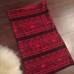 American Apparel Tribal Midi Skirt Red tribal midi skirt that can be worn as a dress, top, long or short skirt. Stretchy cotton material so it can fit small and medium and maybe even large. So cute for your next festival party! American Apparel Skirts Midi