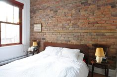 Look how cool this brick wall is with an old beam of reclaimed wood inside it! Neat.