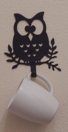 owl wall hooks set of three Each owl is 6 x 5.5 made of metal so they will last for many years. You could use them in any room. These owls can make a cute coat rack, a towel rack in the bathroom,towel rack in the kitchen, even hold your keys. Cant you just see how cute they will look in