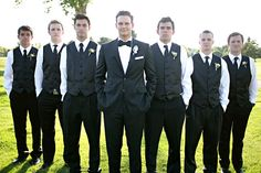 Groom in full suit, groomsmen in vests