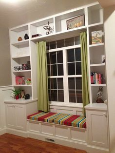 built in shelves around window...love the fabric on the cushion!